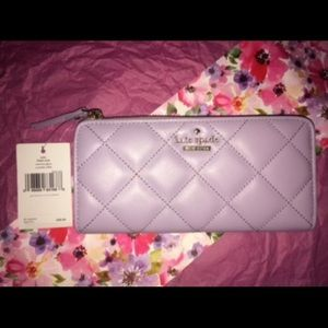 Kate Spade wallet in the color 'Cryviolet'